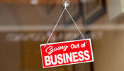 """Going out of business"" sign on window"