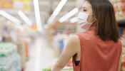 Masked person shopping in grocery store