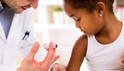 Physician giving shot to child