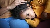 Child in parent's lap