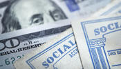 Social Security cards and 20 dollar bills