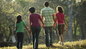 Family Outside Holding Hands