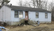 Rancher with boarded windows
