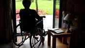 Person in Wheelchair Looking Outside