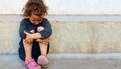 Child Sitting On Street