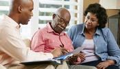Older people reviewing documents