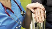 nurse holding hand