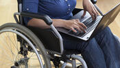 Person in Wheelchair Using Laptop
