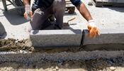 Worker Laying Bricks