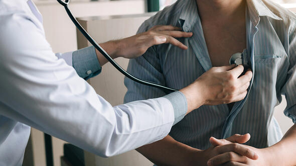 Person being examined with stethoscope