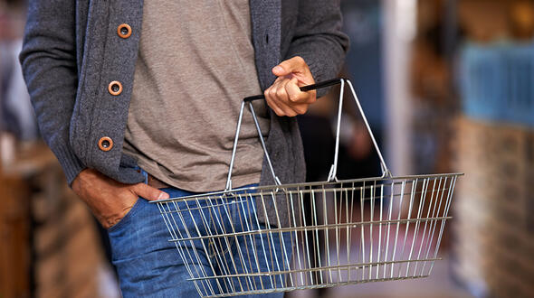 Adult in grocery store with empty basket